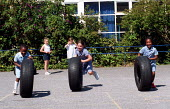 Girls having fun with some tyres during playtime at a Church of England primary school - Stefano Cagnoni - 2000s,2002,appealing,BAME,BAMEs,black,BME,bmes,charming,child,CHILDHOOD,children,Church,churches,cities,city,cultural,cute,diversity,EDU education,EMOTION,EMOTIONAL,EMOTIONS,ethnic,ethnicity,exercise,