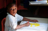 Boy creating an image of Homer Simpson using a graph during a DT lesson in a Church of England primary school - Stefano Cagnoni - 17-07-2002