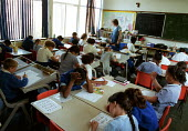 Children taking a written test during a lesson in a Church of England primary school - Stefano Cagnoni - 17-07-2002