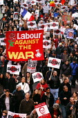 Labour Against The War banner joins Stop The War Coalition demonstration against the visit of US President George W Bush to the UK, London - Stefano Cagnoni - 2000s,2003,activist,activists,Against,banner,banners,blair,bush,CAMPAIGN,campaigner,campaigners,CAMPAIGNING,CAMPAIGNS,Coalition,crowd,DEMONSTRATING,demonstration,DEMONSTRATIONS,dissent,Iraq,London,opp