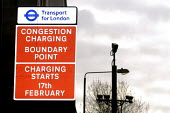 Road sign indicating the beginning of the Congestion Zone, which is to be introduced by Transport for London on February 17th, 2003. In the background are the CCTV cameras which will record the vehicl... - Stefano Cagnoni - 2000s,2003,camera,cameras,cctv,charge,charging,cities,city,CLJ,communicating,communication,CONGESTED,congestion,congestiOn Charge,congestiOn Charge,congestiOn Charges,crime prevention,cross,crosses,cr