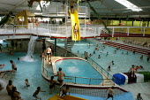 Holidaymakers enjoying themselves in a huge swimming pool complex at Duinrell, near Wassenar in Holland - Stefano Cagnoni - 23-04-2003