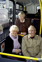 Elderly passengers sharing a joke on board a London bus - Stefano Cagnoni - 24-01-2003