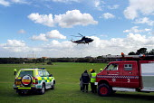 Emergency services on standby as helicopter lifts off. - Stefano Cagnoni - 17-09-2004