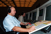 Air Traffic Controller working as part of a 3 man team at the National Air Traffic Service centre, Swanwick, Hampshire - Stefano Cagnoni - 04-10-2004