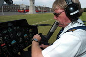 Helicopter pilot checks time on his watch before taking off - Stefano Cagnoni - 05-07-2004