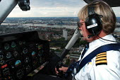 Helicopter pilot on flight above London - Stefano Cagnoni - 05-07-2004