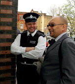 Lee Jasper, advisor to the Mayor of London on police affairs, including police and black community relations, enjoying a joke with a Metropolitan police officer - Stefano Cagnoni - 13-04-2004