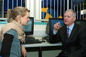 David Bell, Her Majesty's Chief Inspector of Schools, talking to Harriet Quigley, Headgirl at Camden School for Girls, listed by Ofsted as one of a number of schools inspected offering an outstanding... - Stefano Cagnoni - 07-12-2005