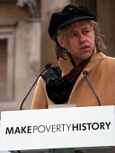 Musician & Campaigner Sir Bob Geldof addresses the thousands gathered in Trafalgar Square at the Make Poverty History rally organised by a coalition of groups lobbying for an end to the debt crisis an... - Stefano Cagnoni - 2000s,2005,activist,ACTIVISTS,CAMPAIGN,campaigner,campaigners,campaigning,CAMPAIGNS,coalition,DEMONSTRATING,DEMONSTRATION,DEMONSTRATIONS,EQUALITY,excluded,exclusion,HARDSHIP,impoverished,impoverishmen
