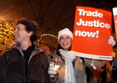 Protestors join an overnight vigil in Whitehall organised by the Make Poverty History campaign calling for Trade Justice within an unfair global economy - Stefano Cagnoni - 2000s,2005,activist,activists,Aid,assistance,banner,BANNERS,CAMPAIGN,campaigner,campaigners,CAMPAIGNING,CAMPAIGNS,candle,Christian,DEMONSTRATING,demonstration,DEMONSTRATIONS,economic,economy,EMOTION,E