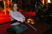 Young girl observes a light projection made visible by her quickly waving a magic wand at the Science Museum in Paris - Stefano Cagnoni - 21-02-2005