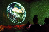 Visitors watch a 360 degree screen projection depicting the dangers to the world of global warming at the Science Museum in Paris - Stefano Cagnoni - 21-02-2005