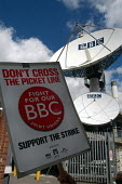 Striking BBC workers placard held up beside BBC satellite dishes at Television Centre in West London on the first day of strike action by NUJ Bectu & Amicus joint unions' at the BBC against cuts in jo... - Stefano Cagnoni - 23-05-2005