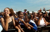 Teenage girls enjoying the free RISE festival held at Burgess Park in Southwark organised by the Greater London Authority - Stefano Cagnoni - 16-07-2005