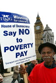 Walter Joseph, 83 years old and in Britain from his homeland of Dominica since 1955, still has to work as a contract cleaner on low wages at the Houses of Parliament to survive. Today he is on strike... - Stefano Cagnoni - 2000s,2005,action,age,ageing population,Big Ben,black,BME Black minority ethnic,cleaner,cleaners,CLEANING,cleansing,commons,dispute,DISPUTES,EARNINGS,elderly,EQUALITY,Houses,Income,INCOMES,industrial,