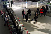 Passengers using the automatic barriers at Stratford Station on the Jubilee Line. London - Stefano Cagnoni - 04-12-2005