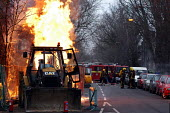 Firefighters carefully approach a blaze caused by a JCB digger fracturing a gas pipe whilst digging the road - Stefano Cagnoni - 30-01-2005