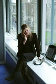 Businesswoman taking a call on her mobile telephone during a break in a conference - Stefano Cagnoni - 04-04-2006