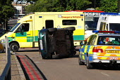 Police and ambulance at the scene of a overturned car involved in an accident at a blackspot junction in Holloway, north London. In the past 3 years 17 collisions have occurred at this junction, one i... - Stefano Cagnoni - 14-07-2006