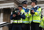 Police photographer at work recording participants at a Freedom of Expression rally held at Trafalgar Square, The rally was called to highlight attacks on freedom of speech and censorship of political... - Stefano Cagnoni - 25-03-2006