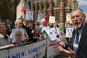 Thousands of widows will not receive full compensation for their husbands' deaths from asbestos related cancer, Law Lords have ruled. Outside the House of Lords John Battle MP sympathises with wives,f... - Stefano Cagnoni - .,2000s,2006,activist,activists,asbestos,asbestosis,bereaved,campaign,campaigner,campaigners,CAMPAIGNING,CAMPAIGNS,cancer,CANCERS,compensation,DEATH,deaths,DEMONSTRATING,DEMONSTRATION,DEMONSTRATIONS,d