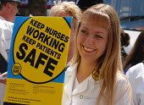 NHS workers protest against health service job cuts. - Stefano Cagnoni - 2000s,2006,activist,activists,against,campaign,campaigner,campaigners,campaigning,CAMPAIGNS,DEMONSTRATING,demonstration,DEMONSTRATIONS,female,health,lobbying,national health service,NHS,nurse,nurses,N