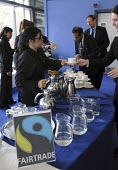 Fair Trade coffee being served at a conference held at the QEII Conference centre in London - Stefano Cagnoni - 2000s,2006,agencies,agency,aid,asian,asians,BAME,BAMEs,BME,bmes,catering,charities,charity,chinese,cities,city,coffee,conference,conferences,diversity,EARNINGS,EMOTION,EMOTIONAL,EMOTIONS,EQUALITY,ethn