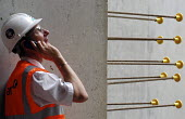 Construction worker supervising operations on a building site - Stefano Cagnoni - 23-07-2007