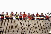 Construction workers watching tunnelling on a building site from a safe distance - Stefano Cagnoni - 23-07-2007