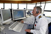 Staff on duty at the Maritime & Coastguard Agency, monitoring shipping passing through the Dover Straits by radar surveillance. - Stefano Cagnoni - 08-11-2007