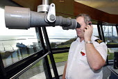 Staff on duty at the Maritime & Coastguard Agency, monitoring shipping passing through the Dover Straits. Looking through a powerful telescope. - Stefano Cagnoni - 08-11-2007