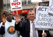 Brendan Barber TUC Gen Sec joins protestors outside the Zimbabwean Embassy in London to demonstrate against Mugabe's oppressive regime, and protest against the violence and torture trades union member... - Stefano Cagnoni - 2000s,2007,activist,activists,ACTSA,against,BAME,BAMEs,black,BME,bmes,CAMPAIGN,campaigner,campaigners,CAMPAIGNING,CAMPAIGNS,Change,DEMONSTRATING,demonstration,DEMONSTRATIONS,diversity,ethnic,ethnicity
