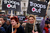 Women carrying Troops Out banners at the No Trident rally in Trafalgar Square, calling on a halt to the nuclear arns race and a pull out of troops from Iraq - Stefano Cagnoni - 24-02-2007