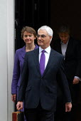 The Rt Honourable Alistair Darling MP emerges from No 11 Downing Street to present his first Budget as Chancellor of the Exchequer - Stefano Cagnoni - 2000s,2008,box,boxes,briefcase,EBF economy finance,EMOTION,EMOTIONAL,EMOTIONS,Gladstone,Government,HM,opportunity,photo,photocall,POL politics,SMILE,SMILES,smiling,Street,tradition,traditional,Treasur