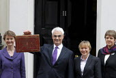 The Rt Honourable Alistair Darling MP emerges from No 11 Downing Street to present his first Budget as Chancellor of the Exchequer to the waiting media photocall. - Stefano Cagnoni - 2000s,2008,box,boxes,briefcase,EBF economy finance,EMOTION,EMOTIONAL,EMOTIONS,Gladstone,Government,HM,media,opportunity,photo,photocall,POL politics,SMILE,SMILES,smiling,Street,tradition,traditional,T
