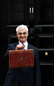 The Rt Honourable Alistair Darling MP emerges from No 11 Downing Street to present his first Budget as Chancellor of the Exchequer. - Stefano Cagnoni - 2000s,2008,box,boxes,briefcase,EBF economy finance,EMOTION,EMOTIONAL,EMOTIONS,Gladstone,Government,HM,opportunity,photo,photocall,POL politics,SMILE,SMILES,smiling,Street,tradition,traditional,Treasur
