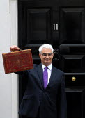 The Rt Honourable Alistair Darling MP emerges from No 11 Downing Street to present his first Budget as Chancellor of the Exchequer. - Stefano Cagnoni - ,2000s,2008,box,boxes,briefcase,EBF economy finance,EMOTION,EMOTIONAL,EMOTIONS,Gladstone,Government,HM,opportunity,photo,photocall,POL politics,SMILE,SMILES,smiling,Street,tradition,traditional,Treasu