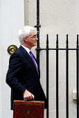 The Rt Honourable Alistair Darling MP emerges from No 11 Downing Street to set off for the House of Commons to present the Labour Government's 2008 Budget to Parliament, his first Budget as Chancellor... - Stefano Cagnoni - 2000s,2008,box,boxes,briefcase,EBF economy finance,EMOTION,EMOTIONAL,EMOTIONS,Gladstone,Government,HM,House,houses,opportunity,Parliament,photo,photocall,POL politics,SMILE,SMILES,smiling,Street,tradi