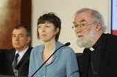 Dr Rowan Williams, Archbishop of Canterbury, answering questions at a TUC Conference on the economic recession entitled: Beyond Crisis. Beside him are Frances O'Grady & Brendan Barber of the TUC. - Stefano Cagnoni - 16-11-2009