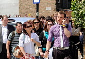 Graduates who have just left University queueing for the London Graduate Fair in London where they are seeking employment. - Stefano Cagnoni - 2000s,2009,a,call,calls,career,careers,CELLULAR,cities,city,communicating,communication,COMPETITATIVE,competition,conversation,conversations,crowd,crowded,dialogue,discourse,discuss,discusses,DISCUSSI