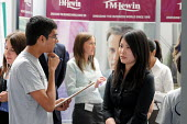 Graduates who have just left University at the London Graduate Fair in London where they are seeking employment. - Stefano Cagnoni - 2000s,2009,a,advice,ADVISE,ADVISER,advisers,advising,advisor,advisors,apparel,asian,asians,BAME,BAMEs,BME,bmes,career,careers,chinese,cities,city,communicating,communication,conversation,conversations
