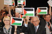 Delegates from the POA at the 2009 TUC in Liverpool hold up posters in support of Palestinian workers during a debate on a motion calling for a boycott of Israeli goods. - Stefano Cagnoni - 17-09-2009