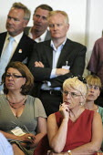 Worried civil servants at the Civil Service LIve Conference listening to proposals for changes to their redundancy compensation scheme and pension rights. - Stefano Cagnoni - 06-07-2010