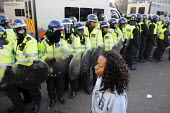 Lone female student faces a phalanx of riot police as she arrives in Parliament Square at the end of a march through London to Parliament to protest against the vote to increase fees for University ed... - Stefano Cagnoni - 09-12-2010