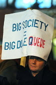 Big Society Equals Big Dole Queue reads a banner held aloft during a rain drenched rally at Islington Town Hall against Government cuts in local council budgets which will severely affect services pro... - Stefano Cagnoni - 14-12-2010