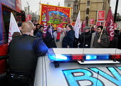 Post office workers blocking the road outside the Department for Business in protest at Government plans to privatise Royal Mail and the Post Office refuse to move when asked to do so by police office... - Stefano Cagnoni - 2010,2010s,activist,activists,adult,adults,blocking,Business,CAMPAIGN,campaigner,campaigners,CAMPAIGNING,CAMPAIGNS,CLJ,CWU,demonstrate,DEMONSTRATING,demonstration,DEMONSTRATIONS,Department,force,Gover