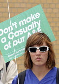 Student nurse from King's College joins Protestors at a rally at The Whittington Hospital in north London, against the closure of the A&E & Maternity Departments. - Stefano Cagnoni - 2010,2010s,activist,activists,against,banner,banners,CAMPAIGN,campaigner,campaigners,CAMPAIGNING,CAMPAIGNS,CLOSED,closing,closure,closures,College,COLLEGES,DEMONSTRATING,demonstration,DEMONSTRATIONS,f