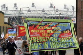 "International Workers"" Memorial Day: protestors march in support of health and safety for workers in the construction industry and elsewhere, with one of the stadia of the new Olympics site in East Lo... - Stefano Cagnoni - 28-04-2010"