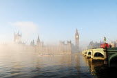 The Houses of Parliament and the river Thames shrouded in early morning mist - Stefano Cagnoni - 2010,2010s,Big Ben,boat,boats,bridge,bridges,bus,bus service,buses,cities,city,cityscape,cityscapes,CLIMATE,Clock Tower,cloud,CLOUDS,cloudy,conditions,Double Decker,EBF,Economic,Economy,government,Hou